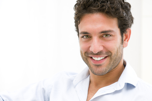 Man in white shirt smiling