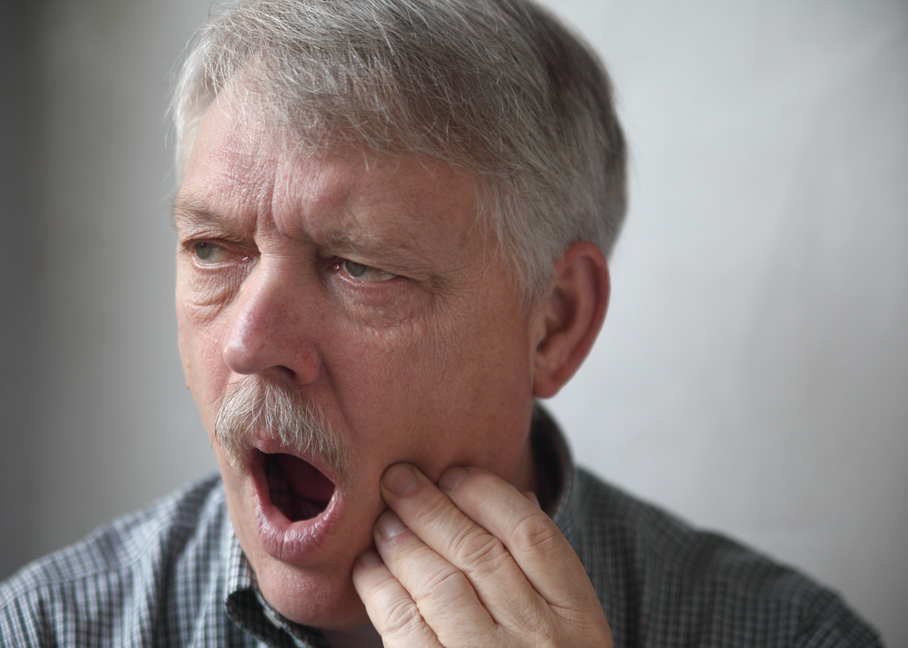 Man with moustache suffering jaw pain